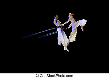 BELARUS, MINSK - JANUARY 12: Kniga Oleg and Kotova Julia doing graceful aerial trick. Circus in Minsk, Belarus on January 12, 2013