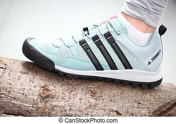 Belarus, Minsk, March 18, 2012. The girl in sneakers Adidas terrex training