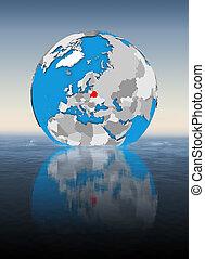 Belarus on globe in water