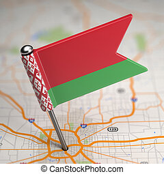 Belarus Small Flag on a Map Background.