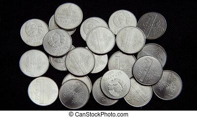 Belarusian coins on black background.