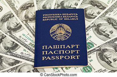 Belarusian passport on US dollars background
