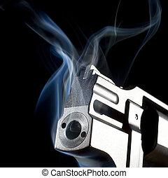 Belching smoke - Handgun that has blue smoke coming from its...