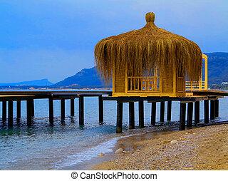 Gazebos built on the beach near the new hotel