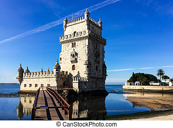 Belem tower against blue sky in Lisbon, Portugal