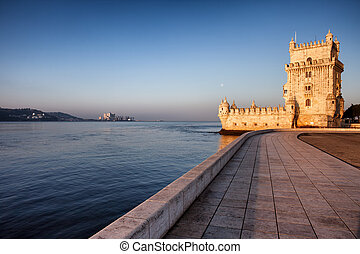 Belem Tower and promenade along Tagus river at sunrise in Lisbon, Portugal.