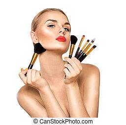 beleza, mulher, com, maquilagem, brushes., aplicando, feriado, maquilagem