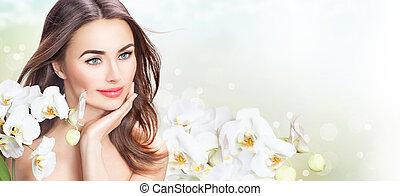 beleza, mulher, com, orquídea, flowers., bonito, spa, menina, tocar, dela, rosto