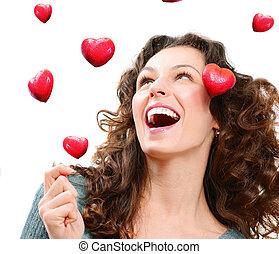 beleza, mulher jovem, pegando, valentine, hearts., amor,...