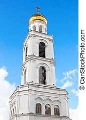 Belfry against the blue sky. Russian orthodox church. Iversky monastery in Samara, Russia