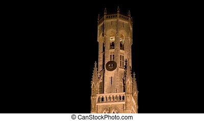 Night view of the medieval Belfry and houses in Bruges, West Flanders, Belgium.