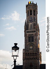 Belfry of Bruges with a lamp in the market square