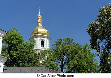 Belfry of the Sophia's Cathedral in Kiev, Ukraine, above the trees
