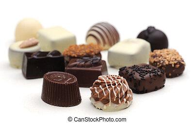 Belgian chocolates on white, shallow depth of field