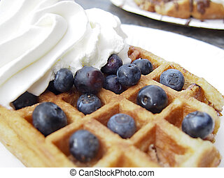 Belgian Waffle - A Belgian style waffle with blueberries and...