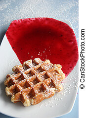 Belgian Waffle - A belgian waffle with sugar icing and red...