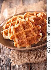 belgian waffle on wood background