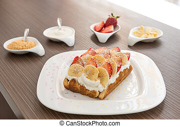 Belgian Waffle with wipped cream, banana and strawberry....