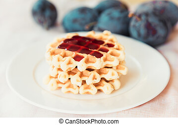 Belgian waffle with plum jam