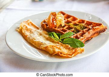 Belgian waffle with honey and fresh mint