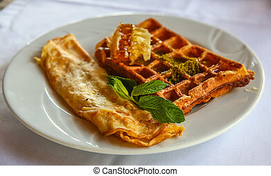 Belgian waffle with honey and fresh mint