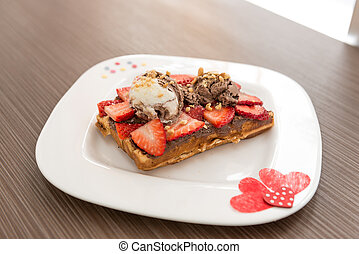 Belgian waffle with ice cream and strawberry. Selective...
