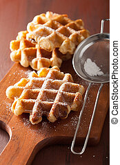 belgian waffles sprinkled with icing sugar