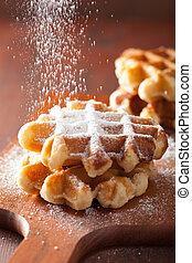 belgian waffles sprinkled with icing sugar