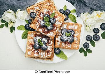 Belgian waffles with blueberries for breakfast - Belgian...