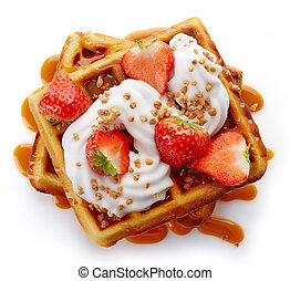 Belgian waffles with caramel sauce, whipped cream and...