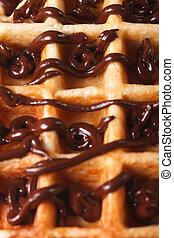 Belgian waffles with chocolate icing macro. vertical ...