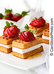 Belgian waffles with fresh strawberries and cream