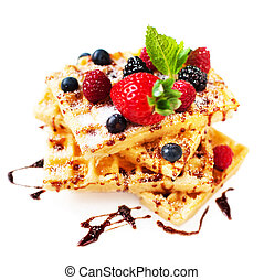 Belgian waffles with ice cream and berry fruits isolated on white background,