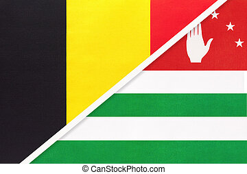 Belgium and Abkhazia, symbol of two national flags from textile. Relationship, partnership and championship between Asian and European countries.