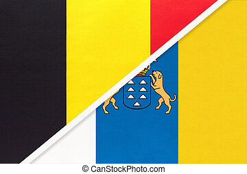 Belgium and Canary Islands, symbol of national flags from textile. Relationship, partnership and championship between two European countries.