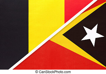 Belgium and East Timor, symbol of two national flags from textile. Relationship, partnership and championship between Asian and European countries.