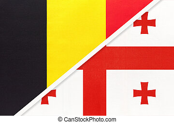 Belgium and Georgia, symbol of two national flags from textile. Relationship, partnership and championship between Asian and European countries.