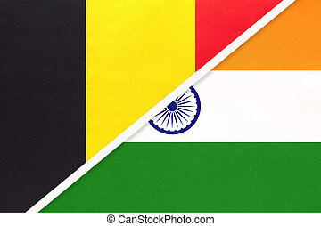 Belgium and India, symbol of two national flags from textile. Relationship, partnership and championship between Asian and European countries.