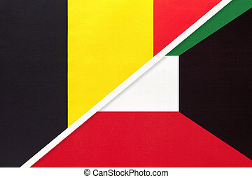 Belgium and Kuwait, symbol of two national flags from textile. Relationship, partnership and championship between Asian and European countries.