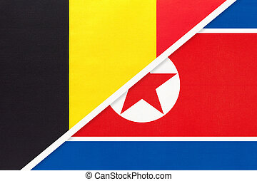 Belgium and North Korea or DPRK, symbol of two national flags from textile. Relationship, partnership and championship between Asian and European countries.