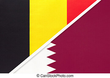 Belgium and Qatar, symbol of two national flags from textile. Relationship, partnership and championship between Asian and European countries.