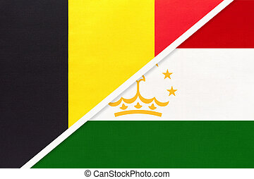 Belgium and Tajikistan, symbol of two national flags from textile. Relationship, partnership and championship between Asian and European countries.