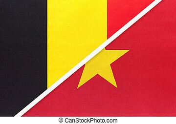 Belgium and Vietnam, symbol of two national flags from textile. Relationship, partnership and championship between Asian and European countries.