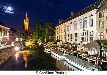 Belgium, Brugge, night cityscape, church and river