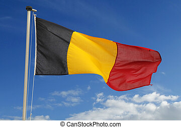 Flag of Belgium fluttering against a cloudy blue sky