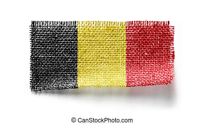 Belgium flag on a piece of cloth on a white background