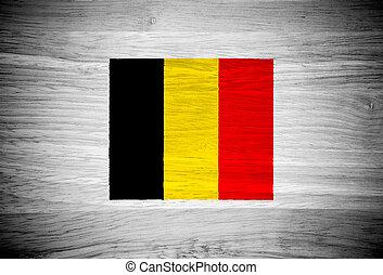 Belgium flag on wood texture