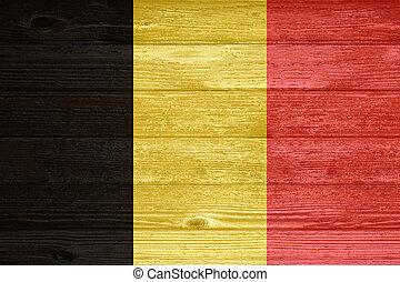 Belgium Flag painted on old wood plank background.