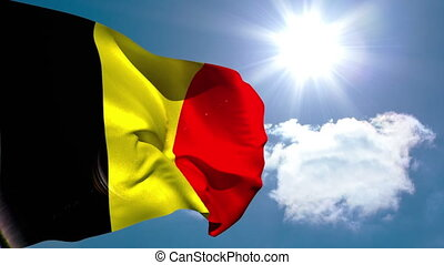 Belgium national flag waving on blue sky background with sun and clouds