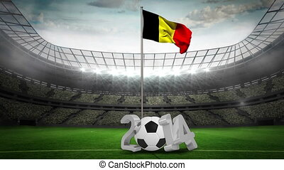 Belgium national flag waving on pole with 2014 message on football pitch